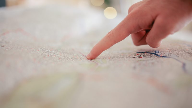 Image of a hand pointing onto a map
