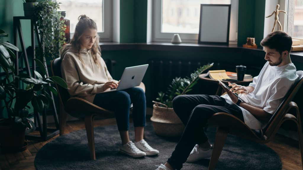 photo of two people using electronic devices